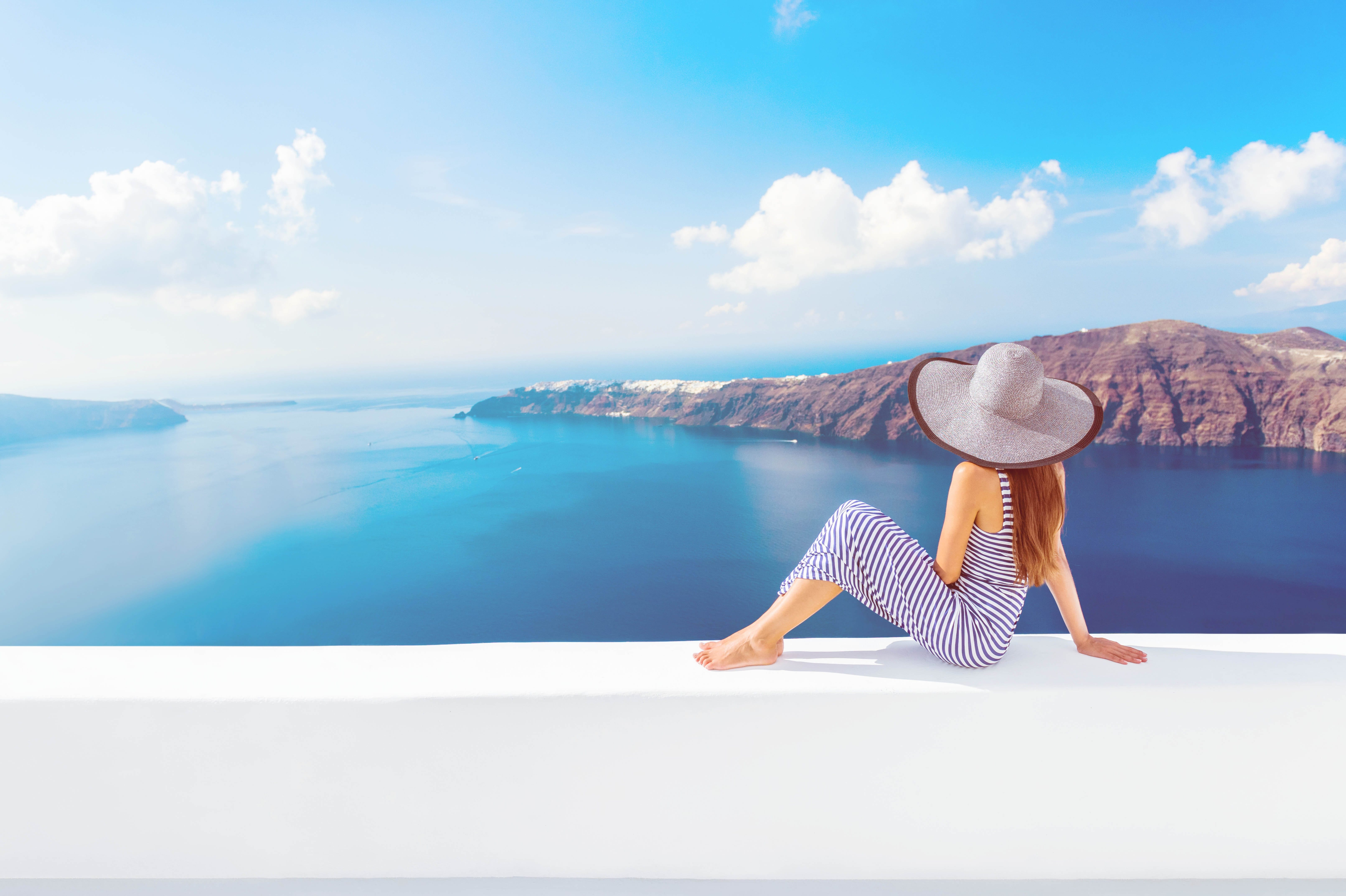 Woman Looking At View At Luxurious Travel Destination.