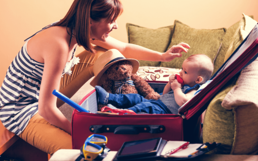 Woman Packing Suitcase For Her Son