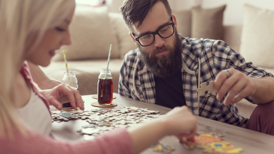 Woman Working On A Puzzle With Her Boyfriend - GET To Stay Home